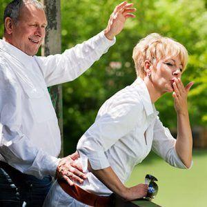 Senior Couple Waving